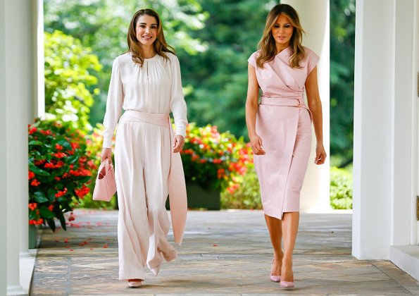 Queen Rania wore a baby pink jumpsuit by Adeam. First Lady Melania Trump wore a pink sleeveless wrap around dress by Proenza Schouler