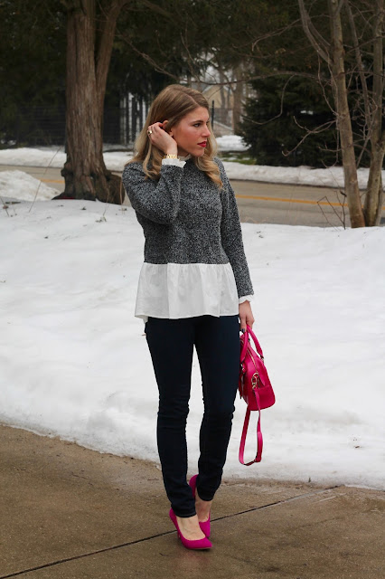 layered grey sweater, jeans, pink heels, and pink bag