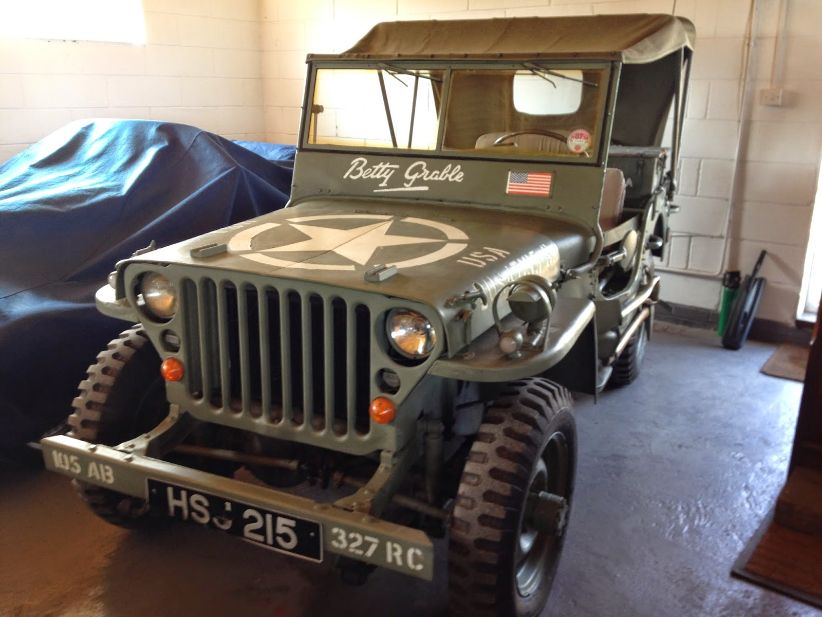 A vintage Jeep parked in the barn at Ramley Farm