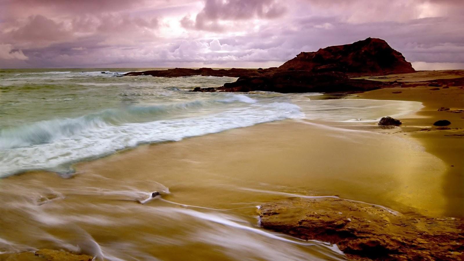 Achtergrond met zand met golven en rotsen