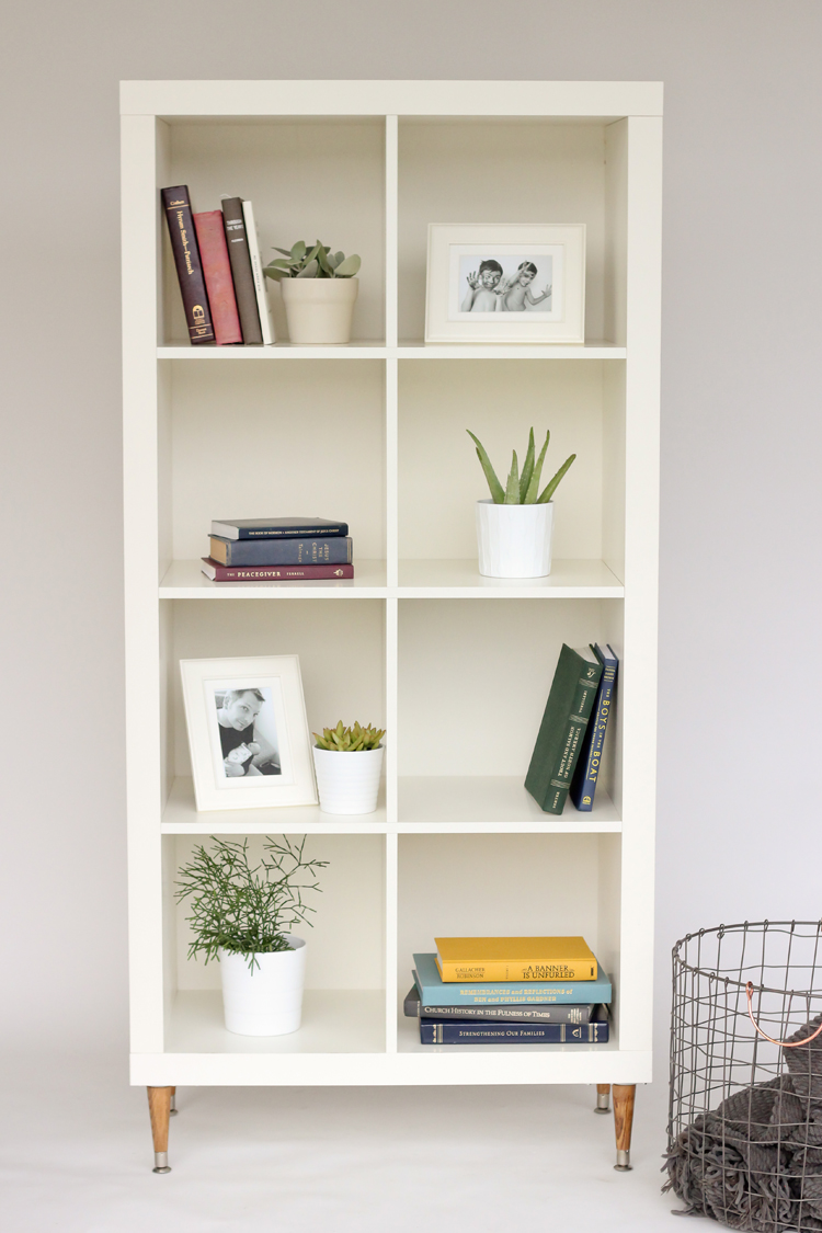 Ikea hack for Kallax shelving with midcentury modern feet - found on Hello Lovely Studio