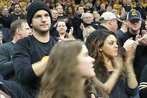 Mila Kunis and Ashton Kutcher on the wrestling match