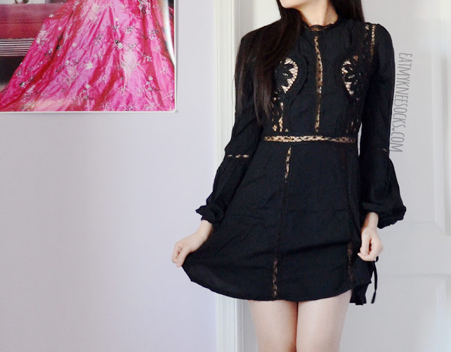 Details on the boho-chic flowy black crochet cutout flared dress from SheIn, a dupe of the Penelope mini dress by For Love and Lemons.