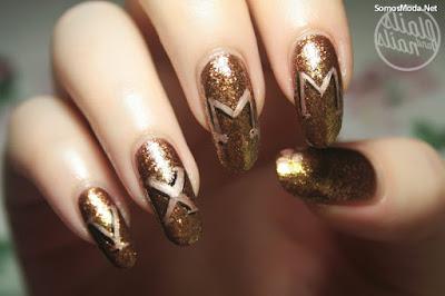 Uñas decoradas elegantes doradas