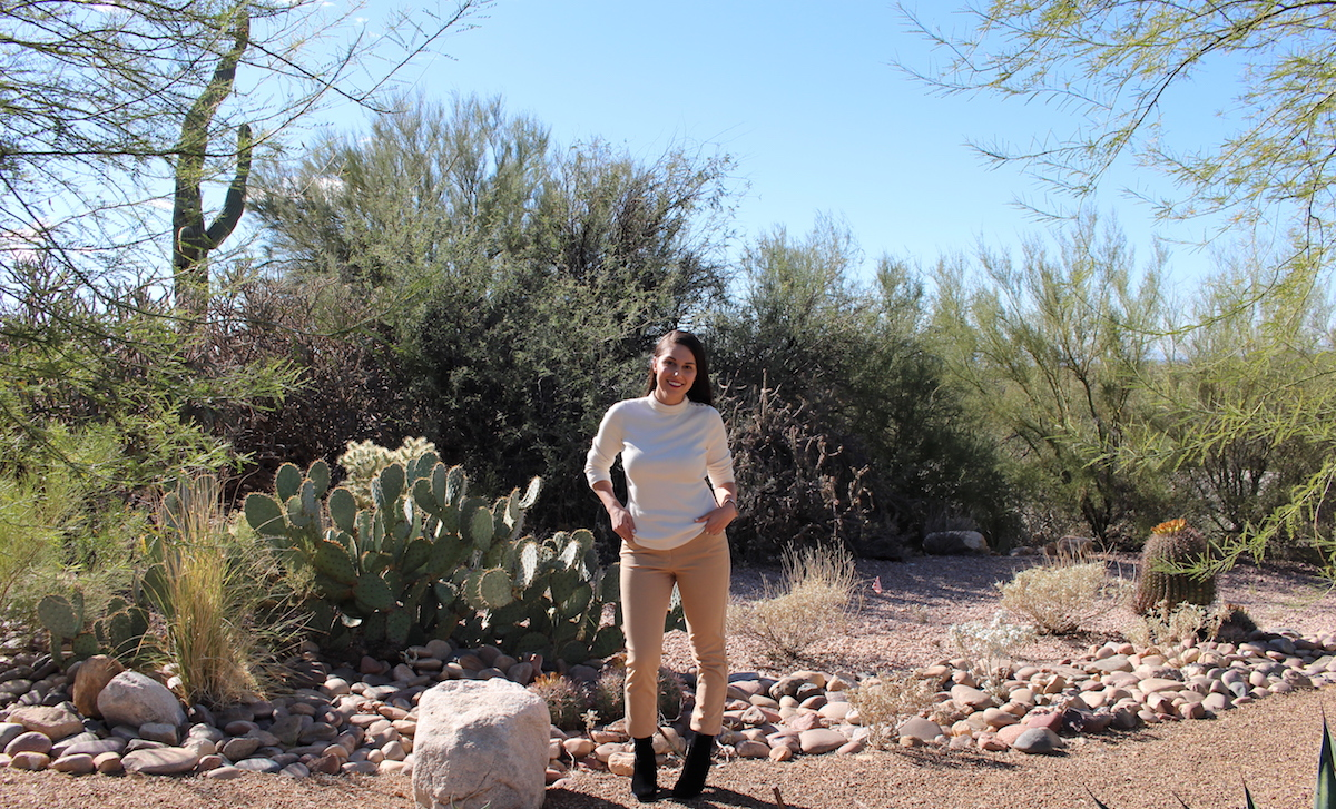 This is a desert shot of me in my white sweater, caramel jeans and black velvet ankle boots.