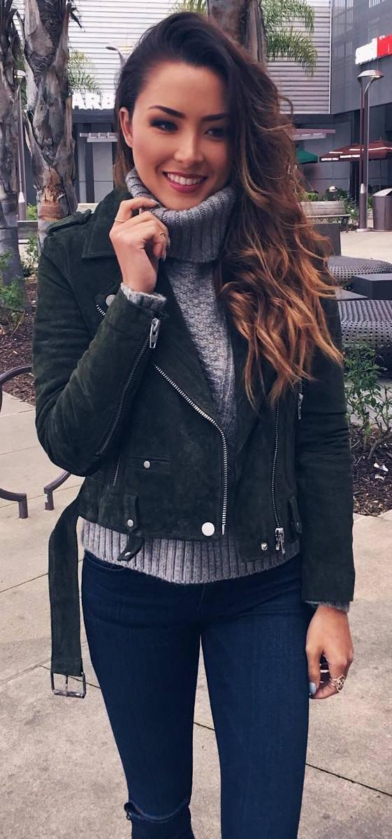 cute outfit idea: grey knit + biker jacket + rips