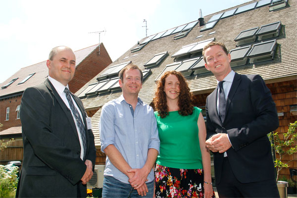 Energy Minister Greg Barker MP (right) with Laura and Nik Glazebrook and Paul Hicks of VELUX, outside the CarbonLight Homes in Northamptonshire.