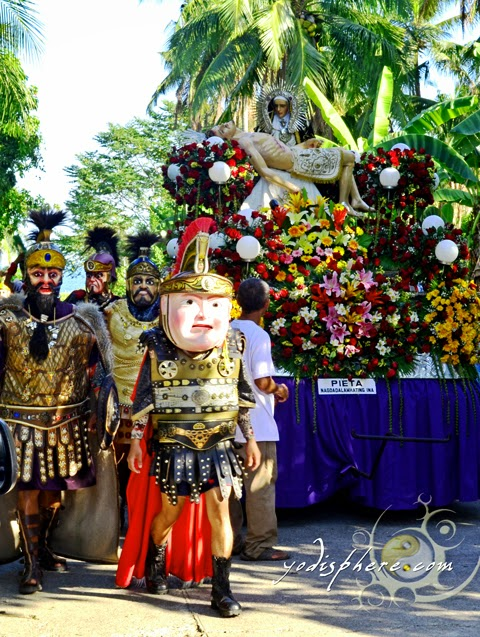 Moriones parade together with statues of saints at the street of Torrijos