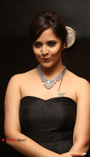 Telugu Anchor Actress Anasuya Bharadwa Stills in Strap Less Black Long Dress at Winner Pre Release Function  0017.jpg