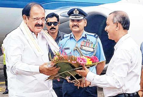 State minister Gautam Deb receives Vice-President Venkaiah Naidu at Bagdogra