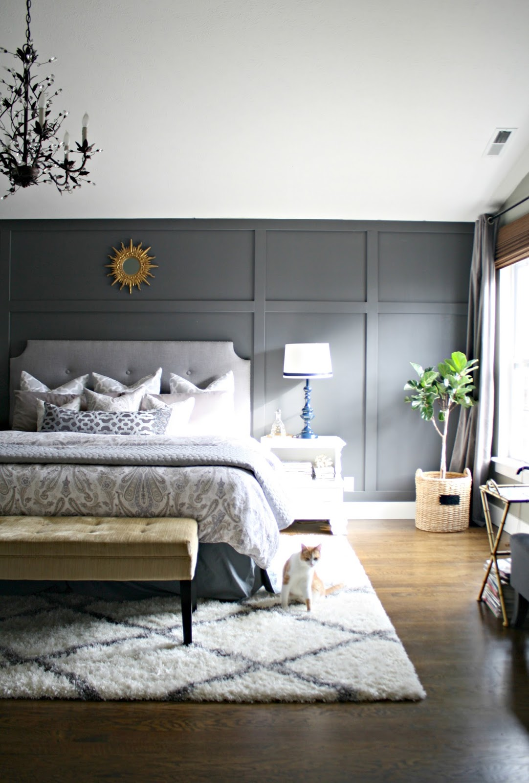 gray wall behind bed with trim