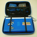 Console case interior with DS Lite and other accessories