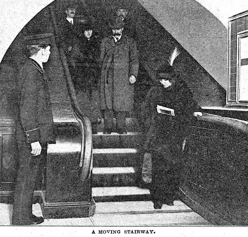 a photograph of a 1920s subway escalator, a moving stairway