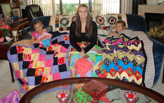 "And here they are! The ""nieces"" with their new quilts from me."