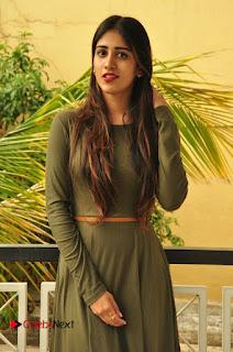 Actress Chandini Chowdary Pictures in Short Dress at Thikka Movie Team Visit to Cancer Striken Children  0035.JPG