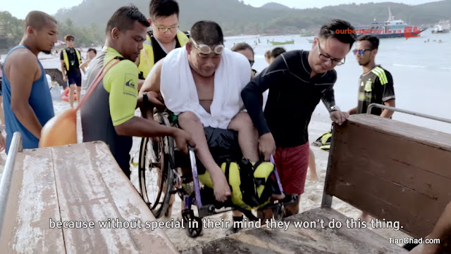 62 volunteers helped 34 persons with disabilities to dive in the sea