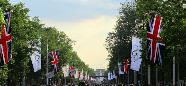 Olympic flags line The Mall toward Buckingham Palace
