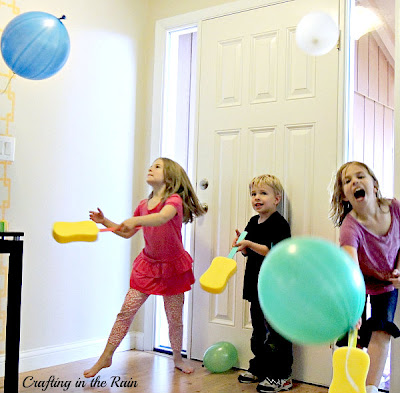kids playing balloon game