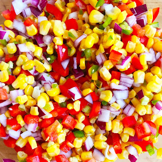 The final product from Better-Than-Chipotle Corn Salsa by www.smokeandvanilla.com - A healthy, fresh, and easy recipe featuring jalapeño, red bell pepper, red onion, and a hint of lime juice. Better than a copycat and delicious served as a dip with tortilla chips, on its own as a side dish, or on top of tacos. http://bit.ly/2olfujf