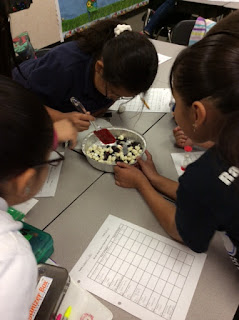 Students had to use different utensils to act as bird beaks as they tried to pick up food.