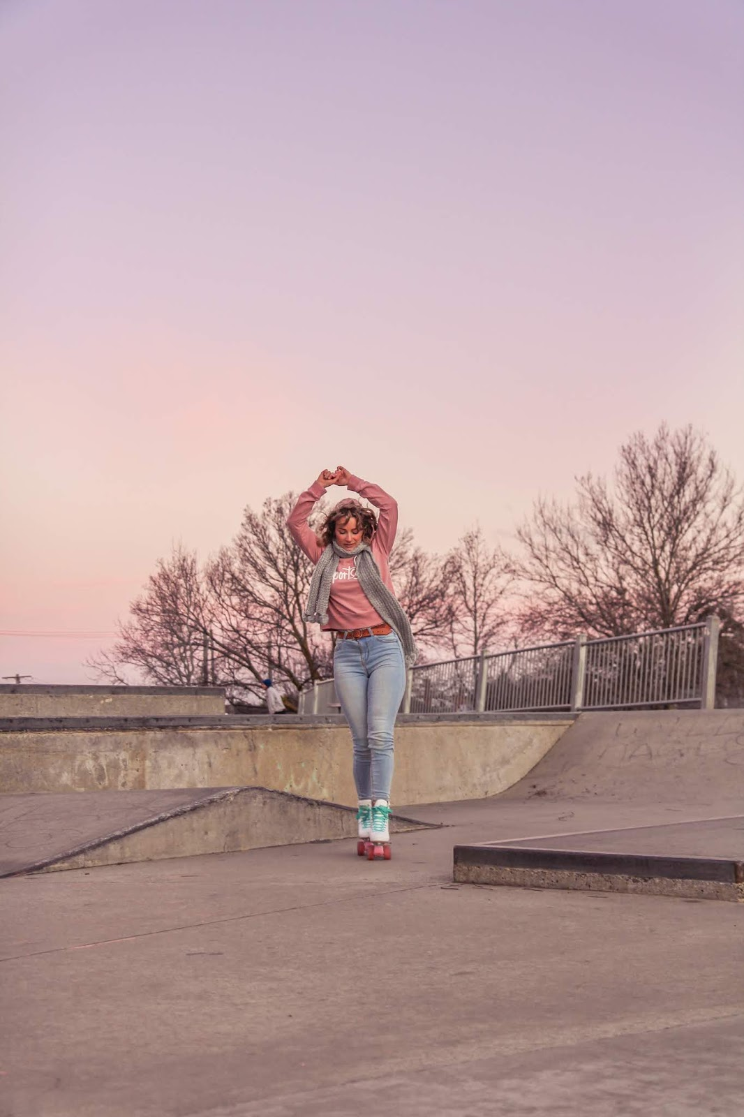 Liana of @findingfemme in Impala roller skates and pink Sportsgirl hoodie