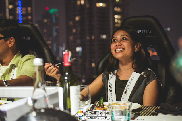 Happy guest having dinner in the sky