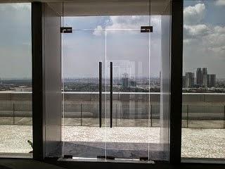 pintu kaca tempered relling