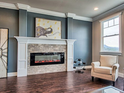 The Touchstone Sideline60 Electric Fireplace is featured in this beautiful custom mantel by Nouvant Homes.