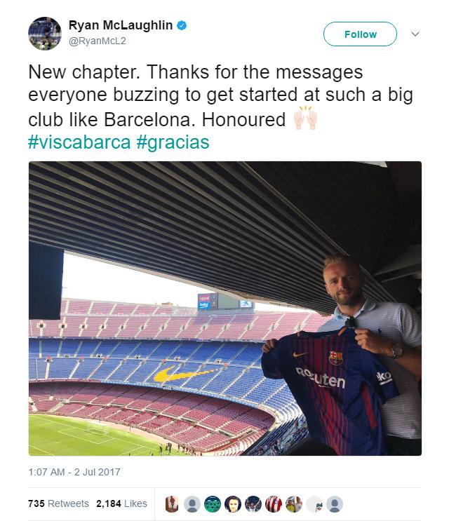 Ryan McLaughlin poses with a Barcelona shirt inside the Camp Nou