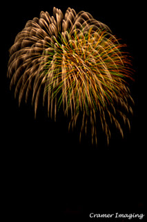 Cramer Imaging's professional quality fine art photograph of feathery golden, green, and red fireworks against the sky in Pocatello, Bannock, Idaho