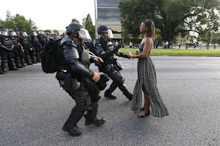 A nurse, a mother and maybe a saint standing in for the arrested Jesus. Baton Rouge