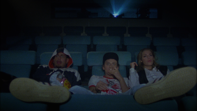 three guys obnoxiously watching a movie in a theater