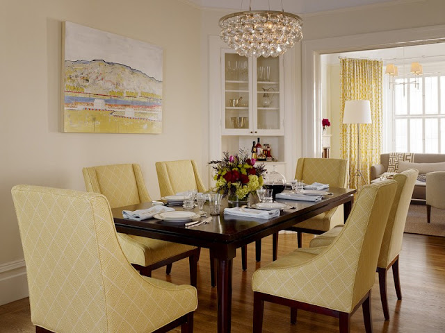 Perfect Dining Room for your beloved family Perfect Dining Room for your beloved family transitional dining room yellow dining chairs dark finishing wood dining table light yellow walls built in corner cabinets in white crystal chandelier yellow draperies medium toned wood floors