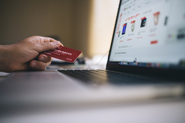 Image of a credit card being used to make an online purchase.