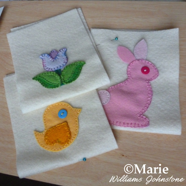 Spring and Easter felt applique motif patterns bunny bird and tulip flower hand sewn onto bag fronts