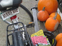 Bike next to a bench full of pie pumpkins