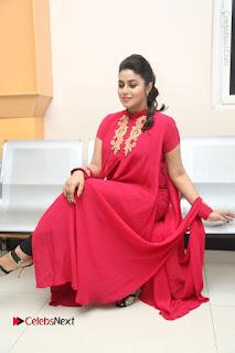 Actress Poorna Latest Stills in Red Dress at Rakshasi First Look Launch  0294.JPG