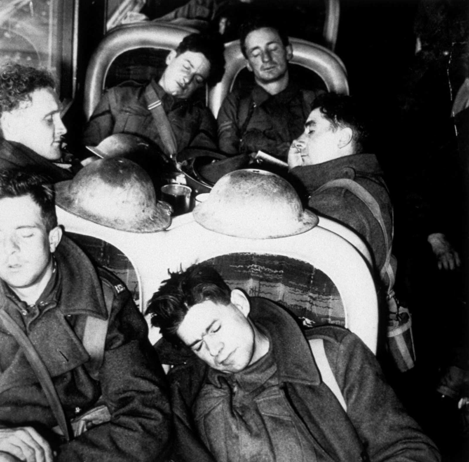 British soldiers sleep aboard a train after escaping from Dunkirk.
