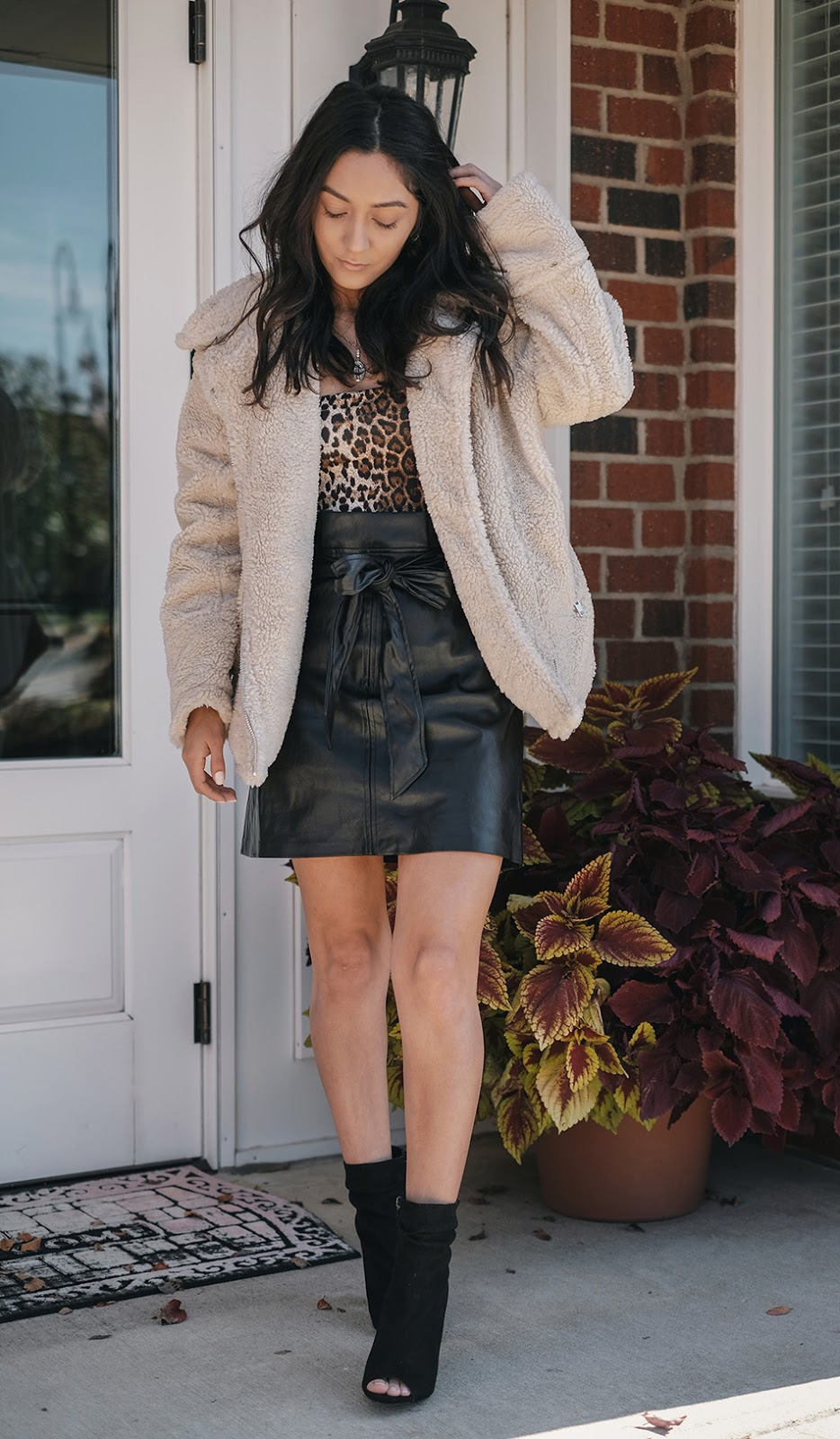how to style sherpa jackets winter cute, how to style leopard bodysuit outfits, how to style scrunched booties