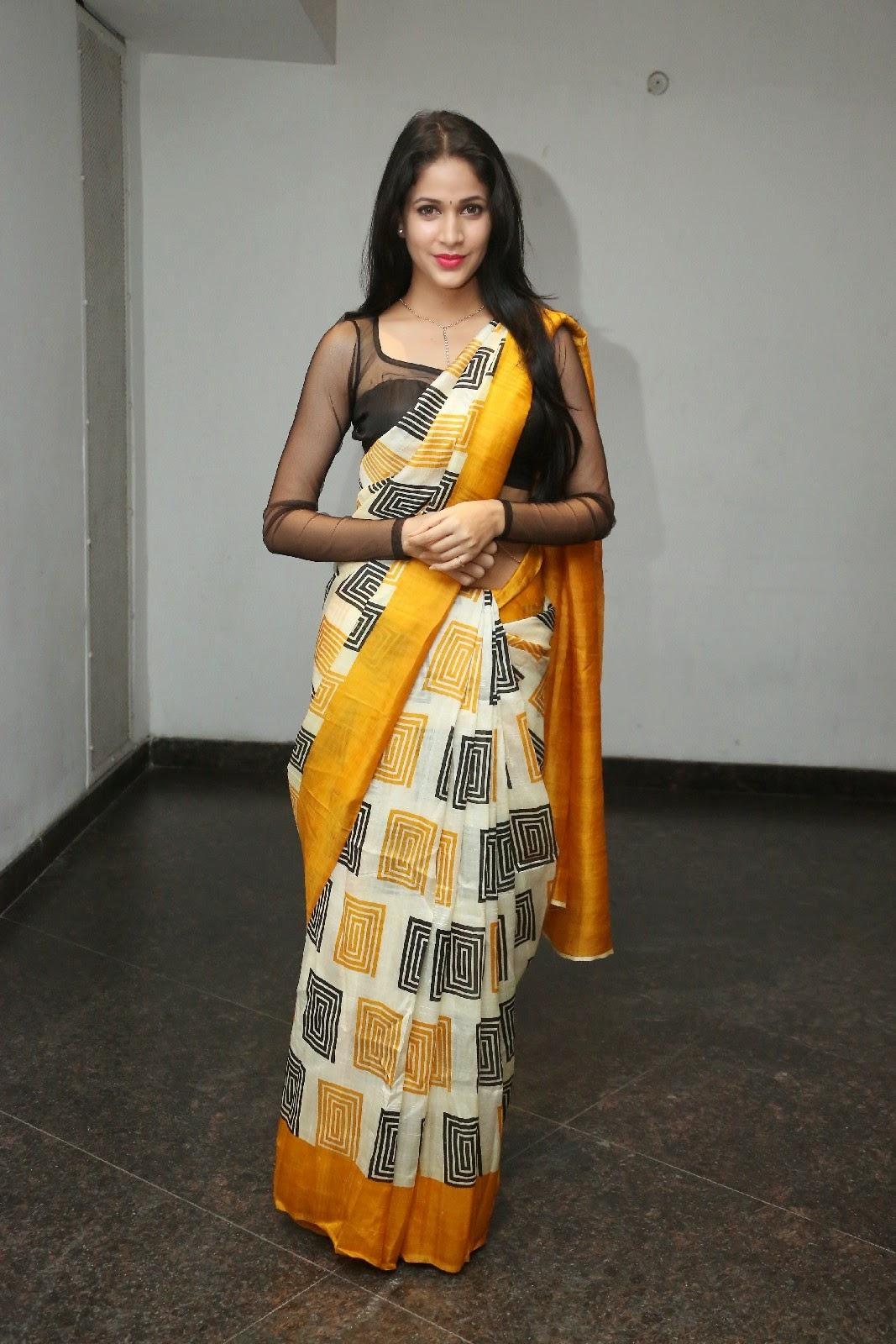 Hot Hip Show Photos Of Lavanya Tripathi In Yellow Saree