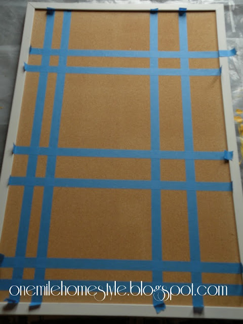 Laying out a bulletin board design with painters tape