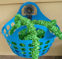 http://happierthanapiginmud.blogspot.com/2016/05/1-hanging-storage-for-flexible-hose.html