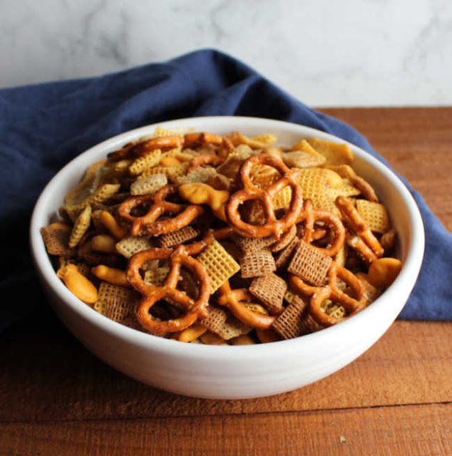 bowl of classic chex with cereals, pretzels and peanuts mix ready to eat