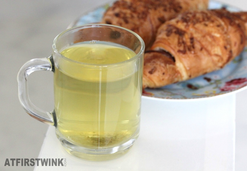 glass of sencha japanese tea cheese croissants