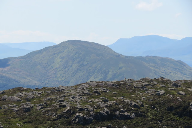 A close up of one of the Moelwyn summits. Other hazy mountain tops in the background.