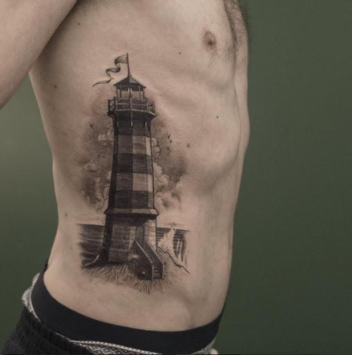 Este preto e cinza farol de tinta de tatuagem