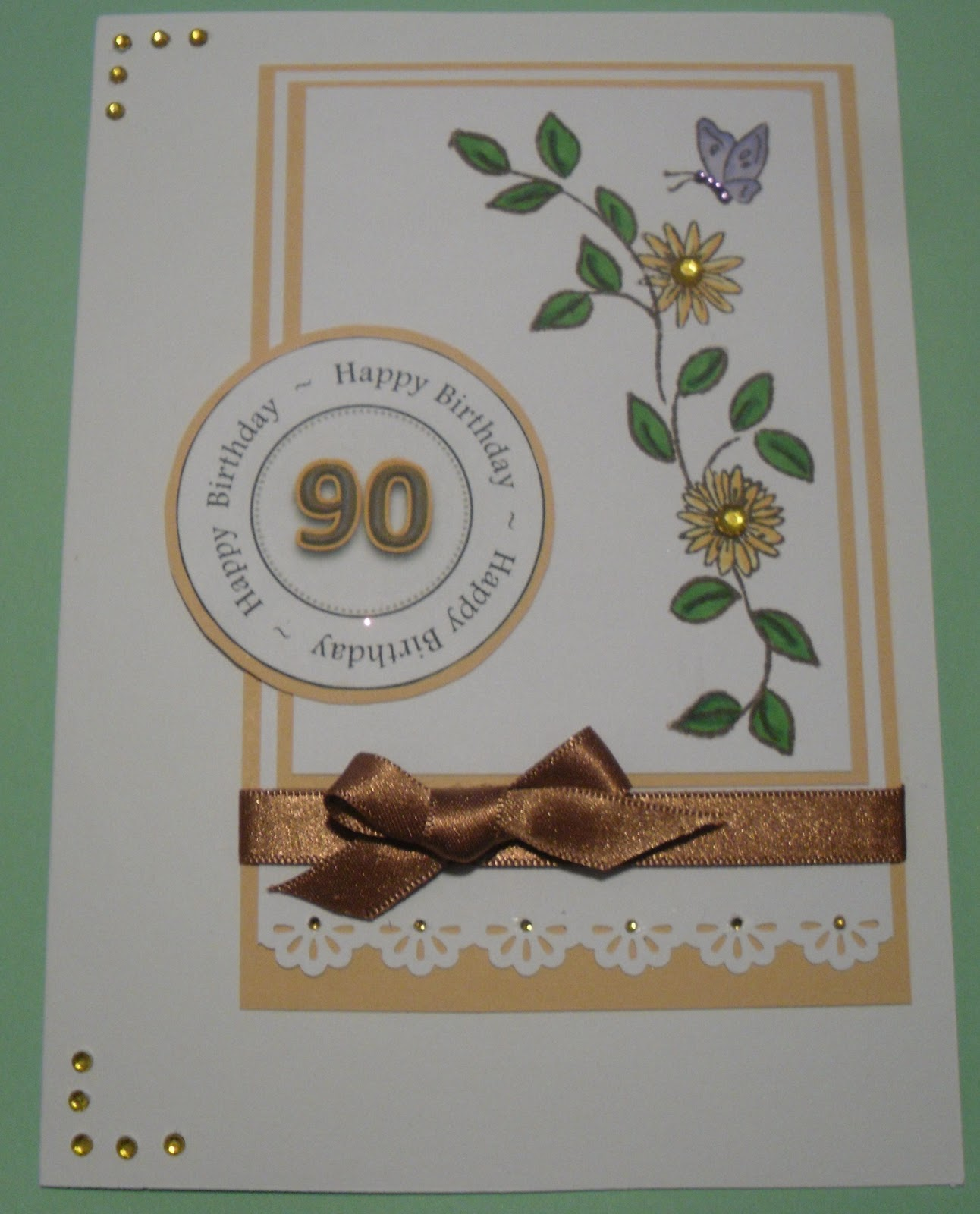I Layered This Card Simply And Added A Puched Border Ribbon From My Stash Some Gems To The Punched Butterfly
