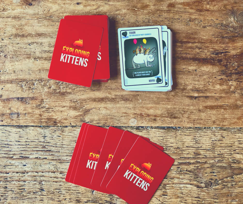 The card game Exploding Kittens set up on our table.