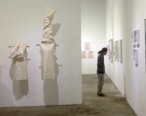 Tinuku Caroline Rika Winata presenting plain white textile installation works in joint exhibition at Bale Banjar Sangkring