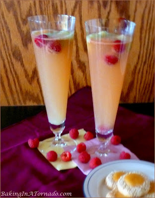 Lemon Raspberry Punch, fresh berries and sherbet make this drink perfect for graduations or any celebration. | Recipe developed by www.BakingInATornado.com | #recipe #cocktail